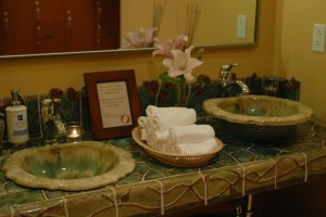 Handcrafted sink and vanity area at Rasa Spa